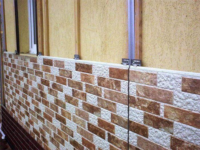 облицовка фасада дома панелями под камень фото