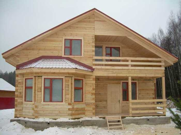 Строительство дома из бруса фото