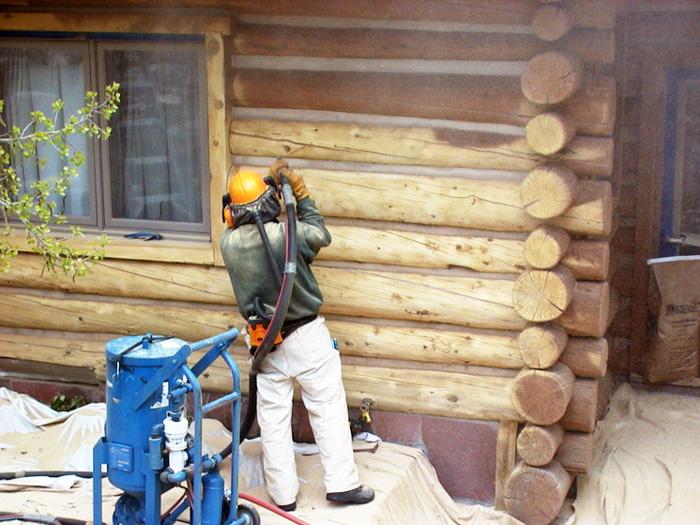 покраска деревянного дома цена за м2