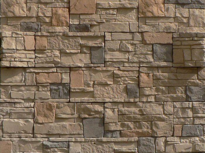 облицовка цоколя дома искусственным камнем