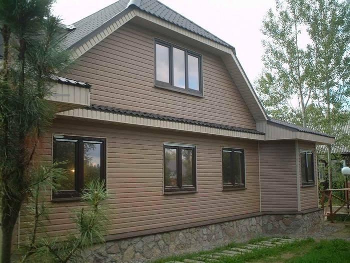 облицовка дома деревянными панелями