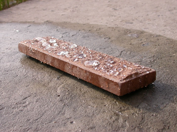 облицовка стен дома искусственным камнем